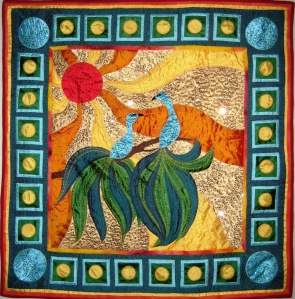 An art quilt made of silk and sequins.